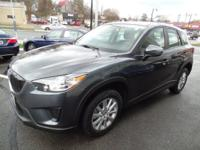 This 2015 Mazda CX-5 Sport is offered to you for sale