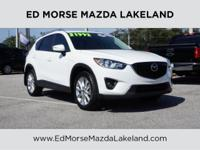 This outstanding example of a 2015 Mazda CX-5 Grand