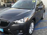 This 2015 Mazda CX-5 Grand Touring is proudly offered