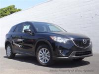 This 2015 Mazda CX-5 4dr FWD 4dr Automatic Touring SUV