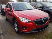 Check out this certified 2015 Mazda CX-5 Touring. Its