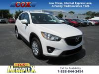 This 2015 Mazda CX-5 Touring in Crystal White Mica is