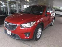 This outstanding example of a 2015 Mazda CX-5 Touring