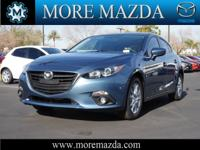 This 2015 Mazda MAZDA3 has a sharp Blue Reflex with a