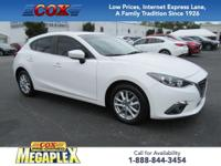 This 2015 Mazda3 i in Snowflake White Pearl Mica is
