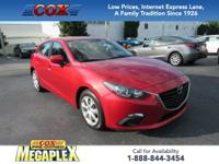 Certified. This 2015 Mazda3 i in Soul Red Metallic is
