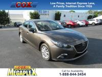 This 1 OWNER, 2015 Mazda3 i in Titanium Flash Mica is
