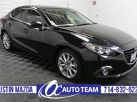 Our 2015 Mazda3 I Touring hatchback in Meteor Gray Mica