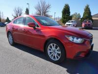 Dolan Mazda Kia is excited to share this vehicle with