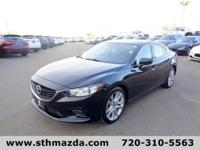 Turn heads with the distinct design of our 2015 Mazda6
