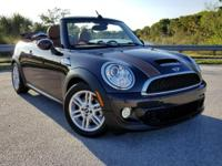 This 2015 MINI Convertible is featured in Brown .
