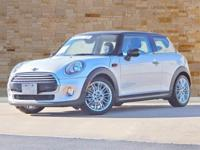 This 2015 MINI Cooper has an original MSRP of $26,650