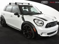This 2015 MINI Cooper Countryman in Light White allows