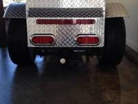 Gorgeous diamond plate custom made cargo trailer for