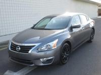You are looking at a Charcoal Gray, 2015 Nissan Altima.