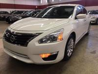 This Nissan Altima Is equipped with keyless entry,