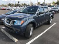 This 2015 Nissan Frontier in Night Armor features.