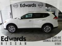 The Nissan Rogue showcases a striking front end,