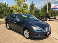 This 2015 Nissan Sentra SL is proudly offered by