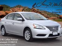 This 2015 Nissan Sentra SV comes with Black cloth