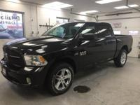 This 2015 Ram 1500 Express in Brilliant Black Crystal