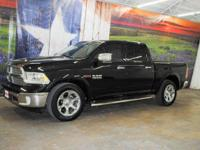 *Rule the roads in this bold black 2015 Certified Ram