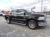 This 2015 RAM 1500 Laramie Limited is complete with