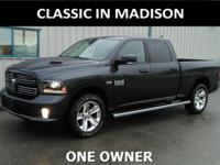 This one owner, 2015 Ram 1500 has a power sunroof,