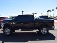 This 2015 Ram 2500 4dr 4WD Crew Cab 149 SLT features a