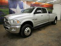 *Rule the roads in this LIFTED shining silver 2015 Ram