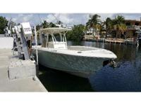 2015 Sailfish 320 CC, FOR SALELIKE NEW. VERY LOW HOURS.