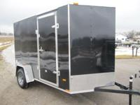 6x10 2015 enclosed trailer with arrow wedge front,
