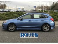 This beautiful, Blue 2015 Impreza Sport is a clean,