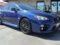 This is a Subaru WRX STI for sale by Empire Exotic