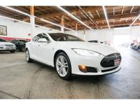 This 2015 Tesla Model S 4dr features a 0.0 ELECTRIC