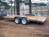 Heres a brand new Texas Bragg car hauler. This trailer