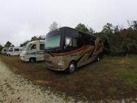 This 2015 Thor Motor Coach Outlaw Toy Hauler is a great