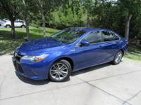 This 2015 Toyota Camry Hybrid 4dr 4dr Sedan SE features