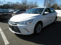 This 2015 Toyota Camry LE, has a great Super White