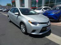 This 2015 Toyota Corolla LE, has a great Classic Silver