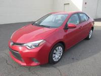 You are looking at an extra clean, Red 2015 Toyota