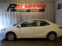 This 2015 Toyota Corolla LE in Super White features: