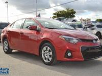You're looking at a 2015 Toyota Corolla S in Flame