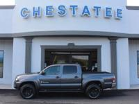 From work to weekends, this Gray 2015 Toyota Tacoma
