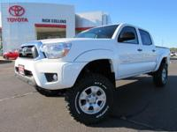 Dealer installed four inch lift kit!! This 2015 Toyota