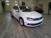 Drive around town in style in the used Volkswagen Eos