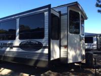 The 2015 Lodge Destination Travel Trailer Model 385FLBH