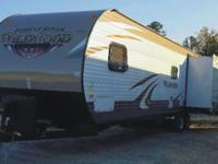 The pre-enjoyed 2015 Wildwood Travel Trailer Model