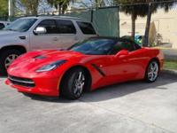 This Torch Red 2015 Chevrolet Corvette Stingray 2LT