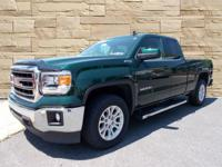 This 2015 GMC Sierra 1500 SLE in Emerald Green Metallic